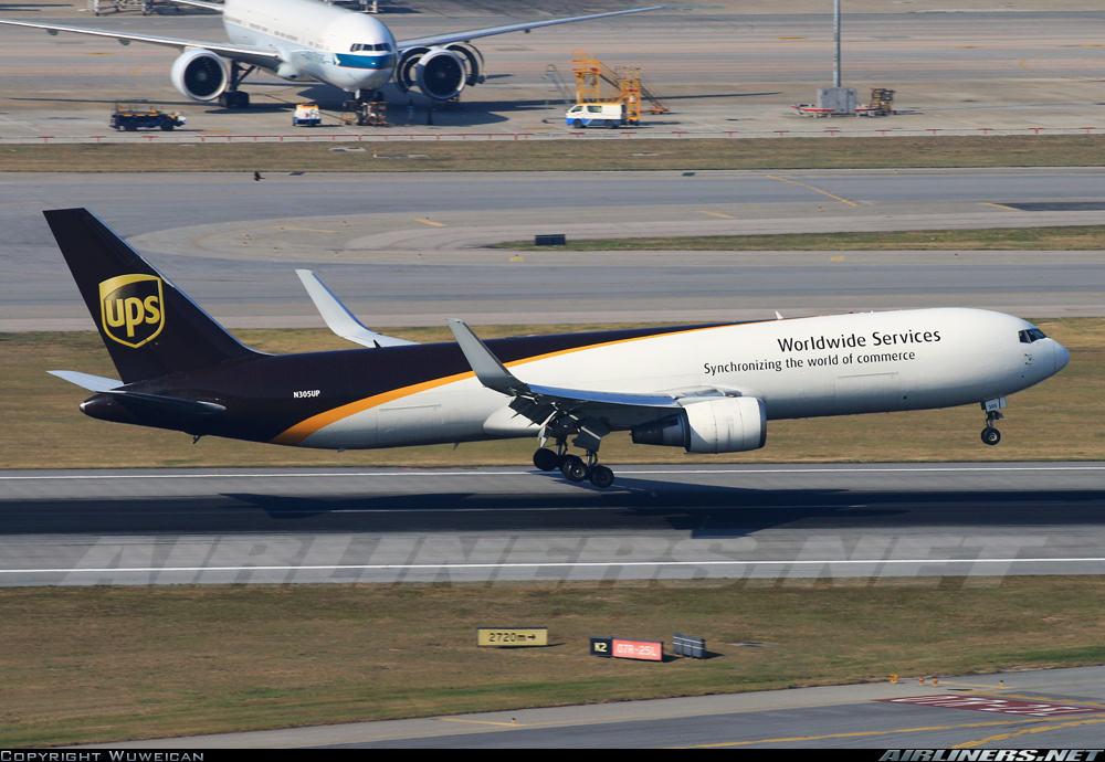 Boeing 767-34AF(ER)(WL) of UPS performs hard landing with tail strike